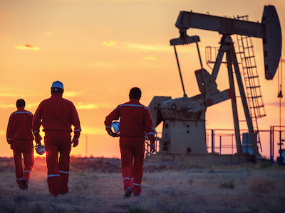 Contractors in the field preparing to use oil and gas field service software to perform tasks